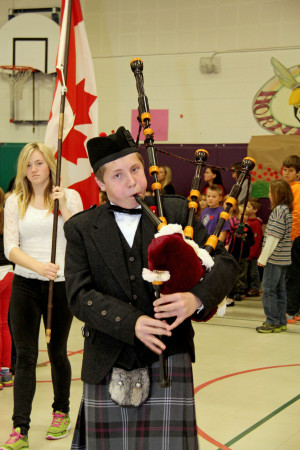 ZHPPS student Fraser Nagle pipes in the Color Party and Wreath Bearers.  Photo contributed by Anita Fraser.